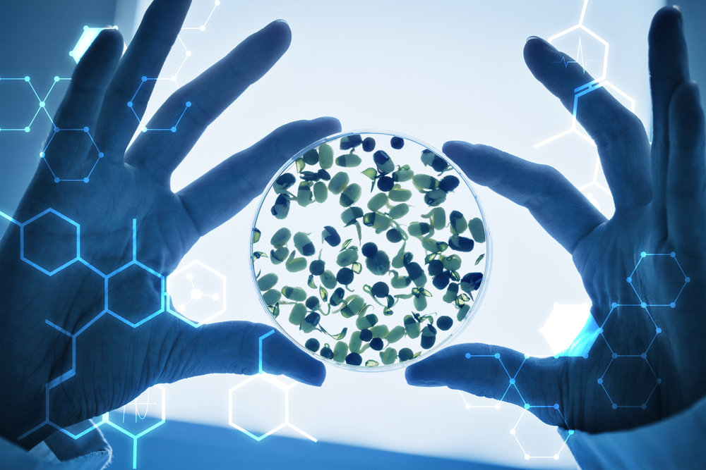 Science graphic against researcher hands holding sprouts in petri dish